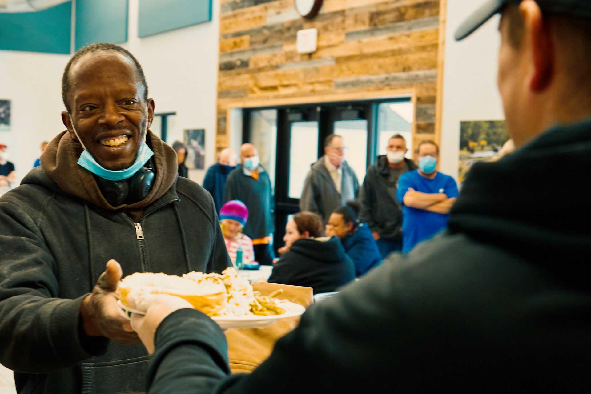 man receiving meal