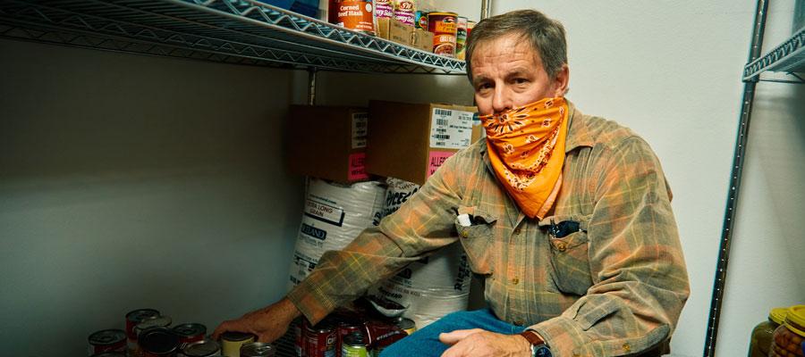 Volunteer with food pantry
